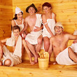 Group people in Santa hat at sauna. — Stock Photo