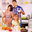 Parents prepare  breakfast. — Stockfoto