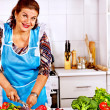 Mature woman preparing at kitchen. — Stock Photo