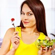 Woman eating salad at kitchen. — Stock Photo