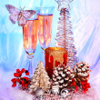 Christmas still life with champagne and candle. ation. — Stock Photo