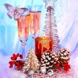 Stock Photo: Christmas still life with champagne and candle. ation.