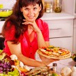 Happy woman cooking pizza. — Foto Stock
