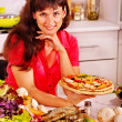 Happy woman cooking pizza. — Stock Photo
