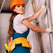 Stock Photo: Woman in builder uniform.