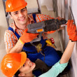 Family in builder uniform indoor. — Stock Photo #35334775