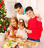 Family with children rolling dough in Xmas kitchen. — Stock Photo