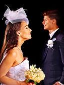 Couple wearing wedding dress and costume. — Stock Photo