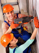Family in builder uniform indoor. — Stock Photo