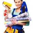 Builder woman with wallpaper. — Stock Photo
