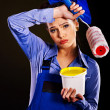 Woman builder with paint cans.. — Stock Photo