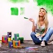 Woman paint wall at home. — Stock Photo