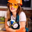 Woman in builder respirator. — Stock Photo