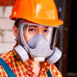 Stock Photo: Man in builder respirator.