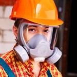 Man in builder respirator. — Stock Photo