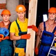 Stock Photo: Men in builder uniform.