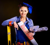 Builder woman with wallpaper. — Photo