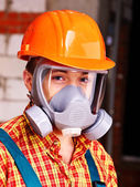 Man in builder respirator. — Stockfoto