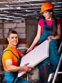 People installing suspended ceiling — Foto Stock