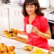 Woman breakfast at kitchen. — Stock Photo