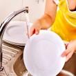 Female hand washing dishes. — Stock Photo