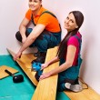 Family laying parquet at home. — Stock Photo
