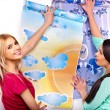 Women glues wallpaper — Stock Photo
