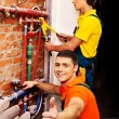 Worker fixing heating system — Stockfoto