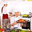 Man and woman in chef hat — Stock Photo
