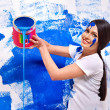 Woman paint wall at home. — Photo