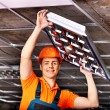 Man installing suspended ceiling — Stock Photo