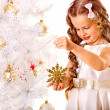 Child and Christmas tree — Stock Photo