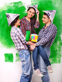 Group people paint wall at home. — Stock Photo