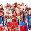 Group people and  Christmas tree. — Stock Photo
