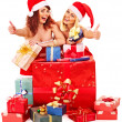 Girl in Santa hat holding Christmas gift box. — Stock Photo