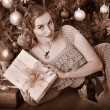 Stock Photo: Woman receiving gifts. Black and white retro.