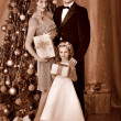 Family with children dressing Christmas tree. — Stock Photo #36642029