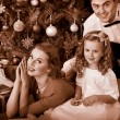 Family with children  dressing Christmas tree. — Стоковая фотография