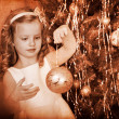 Child decorate on Christmas tree. — Stock Photo #36642093