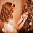 Child decorate on Christmas tree. — Stock Photo