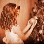 Child decorate on Christmas tree. — Stock Photo