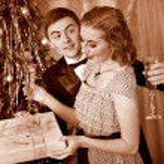 Couple on Christmas party. Black and white retro. — Stock Photo