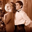 Couple on Christmas party. Black and white retro. — Stock Photo