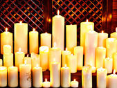 Group lighted candle in spa salon. — Stock Photo