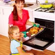 Woman is cooking chicken — Stock Photo