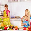Mother and daughter at kitchen. — Stock Photo
