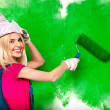 Woman paints wall — Stock Photo