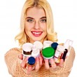 Stock Photo: Womwith pills.