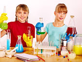 Children in chemistry class. — Stockfoto
