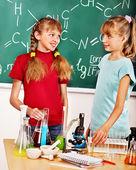 Children in chemistry class. — Stock Photo
